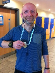 Laurie proudly displaying his Swimathon Medal
